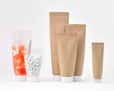 Paper-based material for body of easy to squeeze tube-shaped pouch further reduces plastic volume.